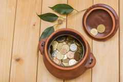 Piggy bank full of coins Stock Images