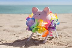 Piggy bank with garland Stock Image