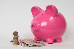 Piggy bank with GBP Stock Photos