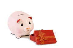 Piggy bank  and gift box isolated on a white background. Royalty Free Stock Images
