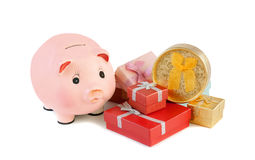 Piggy bank  and gift boxes isolated on a white Stock Photo
