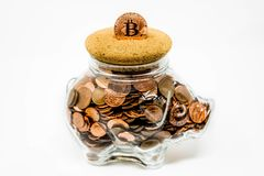 Isolated Clear Piggy Bank Full Of UK 1p and 2p Coins royalty free stock photo