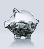 Piggy bank in glass filled with coins Stock Photos