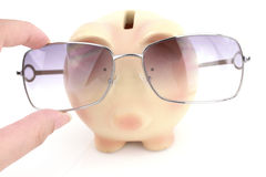 Piggy bank with glasses Royalty Free Stock Photos
