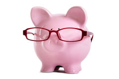 Piggy bank, glasses, old age, wisdom, retirement saving concept Royalty Free Stock Photography