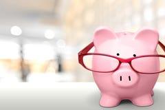 Piggy Bank. Glasses Pension Retirement Financial Advisor Savings Intelligence Stock Images