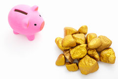 Piggy bank and gold Royalty Free Stock Image