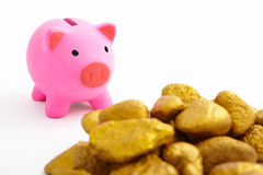 Piggy bank and gold Stock Photos