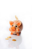 Piggy bank and gold coins Stock Images