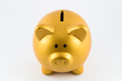 Piggy bank in gold color Royalty Free Stock Photo