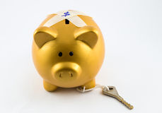 Piggy bank in gold color is locked Stock Images