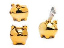 Piggy bank gold color and stack of money safe. Royalty Free Stock Photo