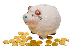 Piggy bank & golden coins Royalty Free Stock Photos