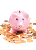 Piggy bank and golden coins Stock Photos