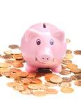 Piggy bank and golden coins Stock Photos