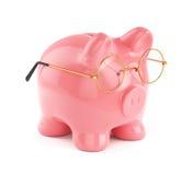 Piggy bank in golden eyeglasses  Royalty Free Stock Photos