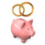 Piggy Bank Golden Wedding Bands. Pink piggy bank with golden wedding bands. White background Stock Photos