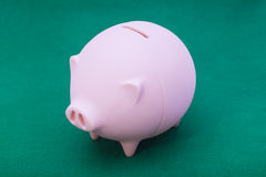Piggy bank on green. Background Royalty Free Stock Photography