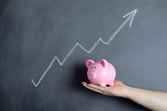 Piggy bank growth chart Royalty Free Stock Photography