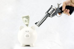 Piggy Bank at Gunpoint Royalty Free Stock Image