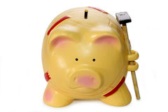 Piggy bank with hammer Royalty Free Stock Image