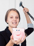 piggy bank with hammer Stock Photo