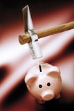 Piggy bank with hammer above, elevated view Royalty Free Stock Photos