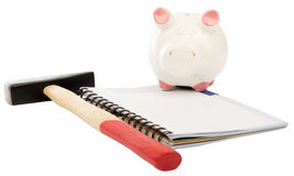 Piggy bank with hammer Stock Photography