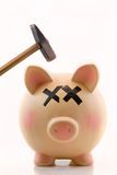 Piggy Bank with hammer over piggy's head Royalty Free Stock Photo