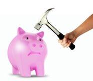 Piggy bank and hammer stock photos