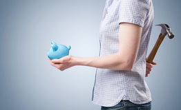 Piggy Bank and Hammer - Using Savings Stock Image
