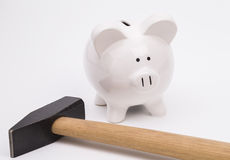 Piggy bank and hammer Royalty Free Stock Photography