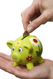 Piggy bank on a hand Royalty Free Stock Photography