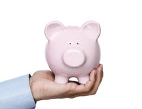 Piggy bank in hand Royalty Free Stock Images
