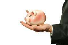Piggy bank in hand stock image