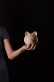 Piggy bank in hand Royalty Free Stock Photo