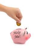 Piggy bank and hand with coin Stock Photos
