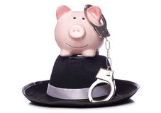Piggy bank with hand cuffs. Studio cutout Stock Photography