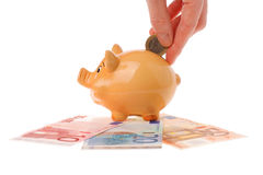 Piggy bank, hand and euro currency Royalty Free Stock Photos