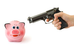 Piggy bank and hand with gun Royalty Free Stock Photo