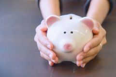 Piggy bank in hand. Royalty Free Stock Photography