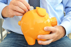 Piggy bank. In the hands Stock Photos