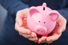 Piggy Bank in Hands Royalty Free Stock Photos