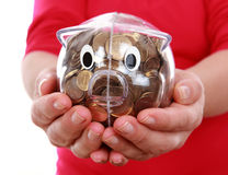 Piggy bank on hands Stock Photos