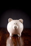 Piggy Bank on Hardwood Floor royalty free stock image