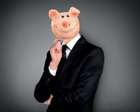 Piggy bank head business man Stock Photo