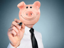 Piggy bank head business man Royalty Free Stock Images
