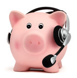 Piggy bank with headset isolated on white backround Stock Photo