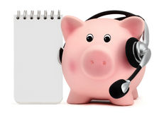 Piggy bank with headset and white block notes Stock Photos