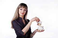 Piggy bank in her hand beautiful woman Royalty Free Stock Image